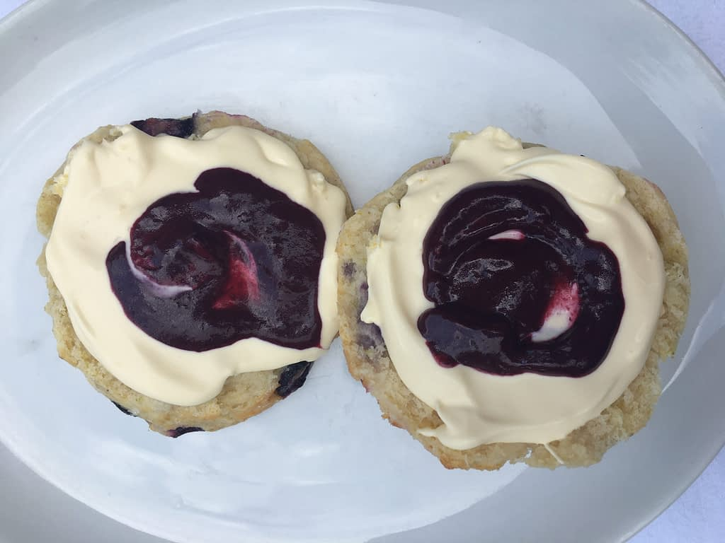 Blueberry and Lime scone cut in khalf with blueberry and lime curd and clotted cream