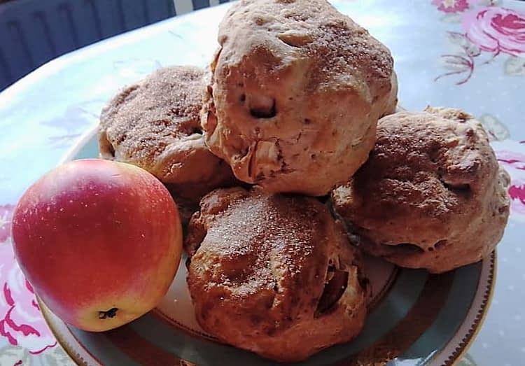 Group of apple and cinnamon scones on a plate with one Worcester apple